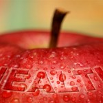 An apple covered with water droplets and text: health.