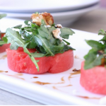 watermelon salad with arugula, goat cheese, and candied walnuts